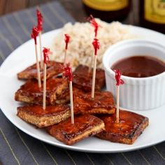 vegan game time grub whether or not you are gluten-free. Thinly sliced tofu is coated in BBQ sauce to create an awesome appetizer or pair with brown rice for a delectable dinner. Tofu Dishes, Vegan Dishes, Grilled Tofu Recipes, Vegan Recipes, Bbq Tofu, Yummy Food, Tasty, Vegan Appetizers, I Love Food