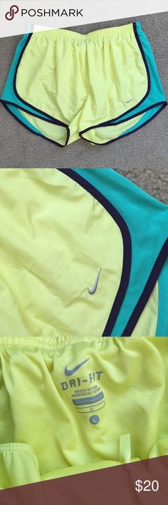 Yellow Nike Shorts Size large yellow and blue Nike shorts. Lined inside. No stains or flaws. Drawstring waisband. I ship daily - excluding Sundays and holidays - and I store items in a smoke free, pet free environment. Open to offers; bundles discounted! No trades. Nike Shorts