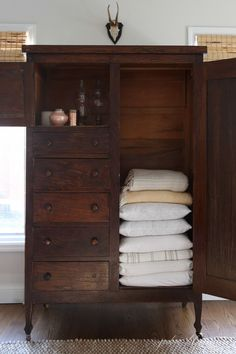 Older homes often have small closets - create additional storage with furniture - like this wardrobe linen closet via /julieblanner/