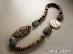 """Necklace """" Africa Calling """" Polymer clay and black iron wire"""