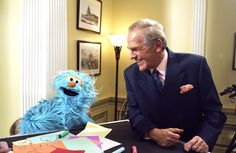 John Spencer and a muppet!  I think it's his smile that makes me love this shot.