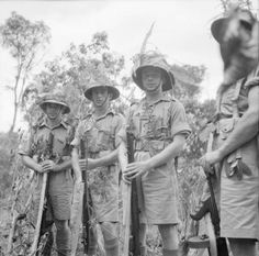 "WW2: British troops in Malaya pose for the military photographer. They carry WW1 vintage Lee-Enfield .303 rifles and a ""Tommy Gun."""