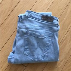 AG The Stevie Ankle Jeans Baby Blue Super cute baby blue jeans. Hard to find this color. Excellent condition except for minor staining on the left front as shown in pic 4. Size 27. Ankle jeans. Inseam 26 inches. Stretchy and comfy.  No trades! AG Adriano Goldschmied Jeans Ankle & Cropped