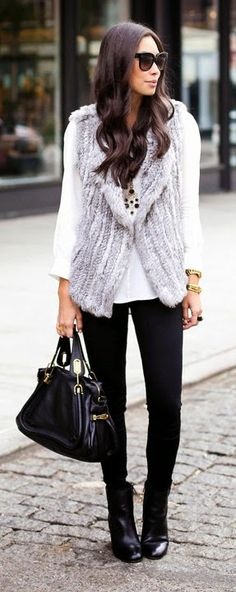 Daily New Fashion : Fall Outfit - Grey fur vest with black legging and leather handbag and long shoes.
