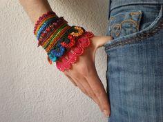Watsonia Borbonica   ... Freeform Crochet Cuff - Flowers -  Magenta Orange Red Indigo Green - Beaded Beadwork. $168.00, via Etsy.