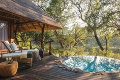 Spend the afternoon on your private deck surrounded by ancient ebony trees watching the Mabrak River run by | Dulini Lodge South Africa. Timbuktu Travel