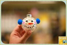 A simple craft for kids to make using bean bag filler, paint pens, and pom-poms inside a clear ornament ... too cute!!