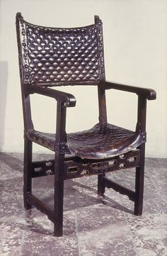 Armchair, Folding  Date: 16th century   Culture: Spanish   Medium: Walnut, leather   Dimensions: 48-3/4 x 24-1/4 in. (123.8 x 61.6 cm)
