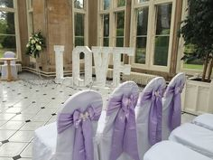Beautiful lilac satin chair bows ready for the ceremony! x