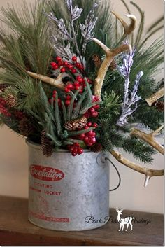 Back Porch Musings Lodge Christmas~ Love the minnow bucket as a vase for shed antlers & greenery and pine cones!