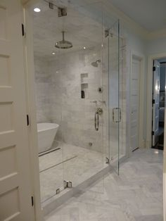 Steam shower with marble tiling. Swing in and out doors with a bathtub inside! #SteamShowerEnclosure