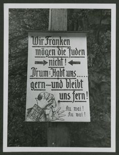 """One photograph from an album of antisemitic signs in Germany. The sign (in German) read, """"Wir Franken moegen die Juden nicht! D'rum: Habt uns ...gern--und bleibt uns fern! Au vai! Au vai!"""" [We Franks do not like Jews! Therefore, you're welcome to stay far away from us!] ANTISEMITISM - GERMANY 1933-45 -- Signs Segregating Jews"""