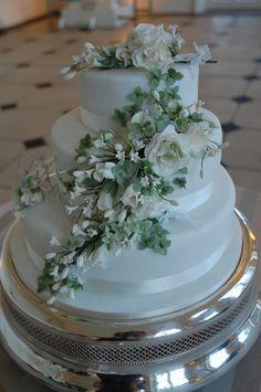 Handmade sugarpaste roses, ivy and hydrangea flowers on three-tier wedding cake www.beautyandthebakery.co.uk