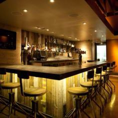 Barn wood bar with concrete top & rope lighting