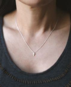 Tiny Cross Necklace in Sterling Silver by MichelleChangJewelry. I really want a teeny tiny cross necklace like this one