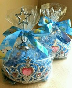 Royal ball princess party favors - wrap small favors in a crown with cellophane! So cute and can do the same crown but with assorted princesses inside so no one gets a princess they don't like.