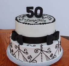 2 tier round 50th birthday cake for woman in black and blue with