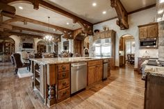 Rustic Kitchen. Jonas Brothers' Texas Home: Striking Rustic Kitchen With Beamed Ceiling