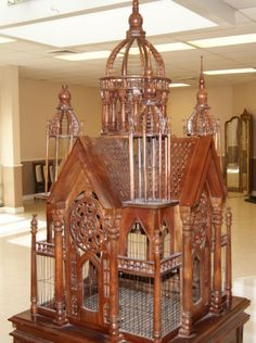 giant hand-carved bird cage
