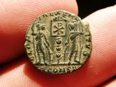 """Constans (Reverse) - this reverse shows one of earliest (337-342) Christian references on a coin - the soldiers are holding a standard with the """"Chi-Rho"""" (XP) that signifies Christ.  It bears the mint mark """"Const"""" which was short for colony Constantina (modern Arles, France)."""