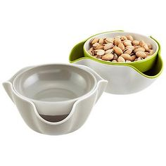 The Container Store > Double Dish™        this would be prefect for pistachio/sunflower shells or eating cherries/olives with pits  Classy & functional