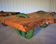 These are oak coffee tables on old cast iron gearwheels. Live Edge Furniture, Outdoor Furniture, Outdoor Decor, Elm Tree, Pine Timber, Tree Table, Oak Coffee Table, Live Edge Table, Barn Wood