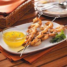 cajun shrimp skewers with cajun hot sauce butter by taste of home. quite possibly the best grilled shrimp i've ever had. Cajun Shrimp Recipes, Seafood Recipes, Grilling Recipes, Cooking Recipes, Healthy Recipes, Shrimp Skewers, Low Carb Dinner Recipes, Seafood Dishes, I Love Food