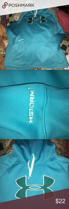 UNDER ARMOUR Cold gear Women's Hooded sweatshirt This is NWOT. NEVER WORE !!   It's a women's medium. Very pretty turquoise/teal color.  Great condition.  I think UA RUNS A LITTLE SMALL so take that into Consideration.  It's marked MED LOOSE.  If you need measurements.  Just ask ❤️. Has pockets also  Under Armour Tops Sweatshirts & Hoodies