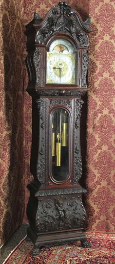 Oak heavily carved grandfather clock by R. Horner (N. Vintage Store has antique clock that might look very cool and steampunkish painted black.
