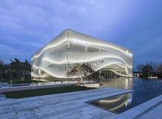 lacime architects cover exhibition hall with undulating façade in suzhou, china Facade Architecture, Amazing Architecture, Landscape Architecture, Landscape Design, Flur Design, Hall Design, Facade Design, Curve Building, Building Facade