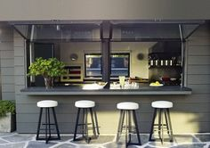 Courteney has a hot-dog window modeled after food trucks in her kitchen in order to serve guests at weekly pool parties with karaoke sessions