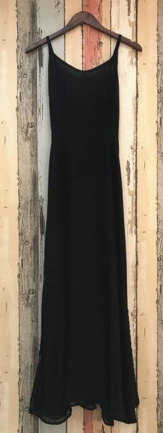 A dress made from chiffon with solid color, spaghetti strap, side slit. It gives you a different look from others.