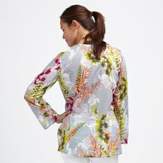We created the design for this beautiful tunic by hand, using a sunprint technique. It's got jungle flower flair with pops of color and layers of interest. Soft and so easy to wear in lightweight, flowy cotton voile. In an open-neck tunic style with side slits at the hem. By the way, Cili is Balinese for prosperity and good health. Tuck it in or wear it out in good health.