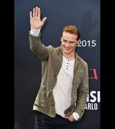 Sam Heughan gives a wave at a photocall for 'Outlander' during the 55th Monte Carlo TV Festival on June 14, 2015