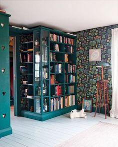 Swedish study. Josef Frank wallpaper.  Love the wraparound library and bright color.