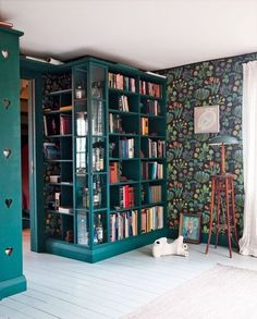 Swedish study. Josef Frank wallpaper.  Love the wraparound library and bright color.