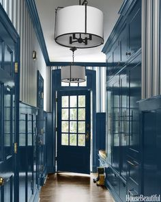 "Eye-popping, high gloss blue ""mud room"" at the side entrance of a bright and happy Charlotte, NC home by Lindsay Coral Harper."