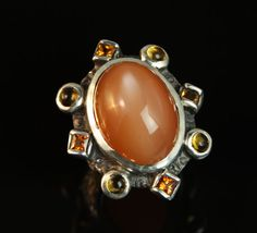 Moonstone in sterling silver ring with princess cut yellow sapphires and citrines. Custom Jewelry Design, Princess Cut, Sterling Silver Jewelry, Dan, Sapphire, Yellow