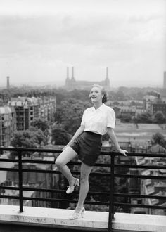 1941: Film actress Georgina Cookson on the balcony of her London home. (Photo by Tunbridge/Tunbridge-Sedgwick Pictorial Press/Getty Images)