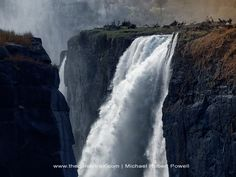 Victoria Falls - the largest waterfall in the world - is impressive, even in the dry season. In fact, the views are better as the falls aren't obscured by mist. Largest Waterfall, Victoria Falls, Africa Travel, Niagara Falls, Worlds Largest, Mists, The Good Place, Seasons, Zimbabwe Africa
