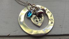 wonder if you can get names instead of grandma???   baby feet sterling handstamped necklace. $68.00, via Etsy.