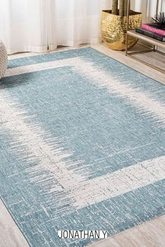 A simple ivory border is woven with a strie' effect on this seafoam aqua geometric rug. This versatile rug's minimalist look is perfect for a coastal cottage or modern outdoor patio. The solid, plain design is a family-friendly solution for a Scandinavian style living room, modern bedroom, kitchen hallway, entry or kids bedroom. Coastal Cottage, Coastal Decor, Indoor Outdoor Area Rugs, Geometric Rug, Home Rugs, Home Decor Trends, Scandinavian Style, Modern Bedroom, Lighting Ideas