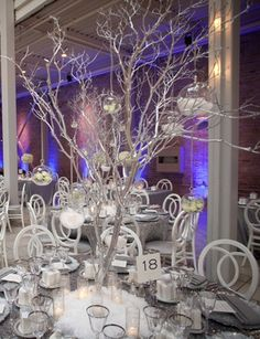Tall tree centerpieces at this Winter-Themed Wedding Reception