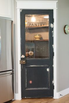 Vintage door repurposed as pantry door - by Rafterhouse.