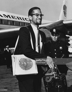 African-American Muslim minister and civil rights activist Malcolm X arriving at John F. Kennedy International Airport, New York City, after a tour of the Middle East, May Get premium, high resolution news photos at Getty Images