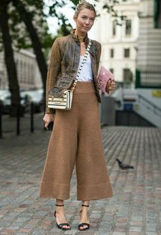 Street style outfit idea: culottes, a distressed leather jacket, and heels