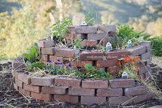 Brick spiral herb garden