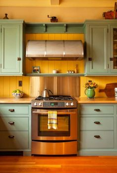 Paint colors are 'Anjou Pear' and 'Stratton Blue' by Sherwin–Williams.  Vintage-looking colors in a bungalow.
