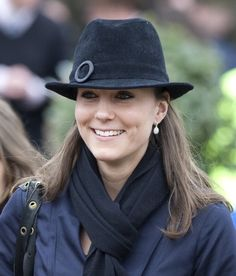 Kate Middleton, with black hat.