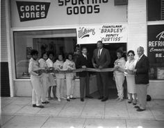Sporting Goods ribbon cutting with L. Coach Fred Jones next to Tom Bradley. Photo by Charles Williams.